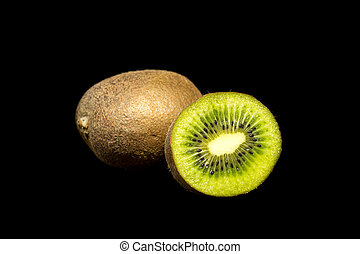 Kiwi fruit slice closeup isolated on black background
