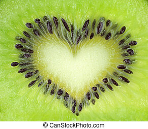 Kiwi fruit slice texture with heart shape