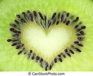 Kiwi fruit slice texture with heart shape Extreme macro shot