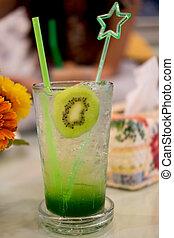 Kiwi fruit slice with soda water in glass