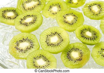 Kiwi fruit with ice on white background