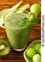 Kiwi honeydew smoothie - glass of fresh kiwi honeydew...