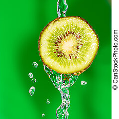 Kiwi in water on a green background