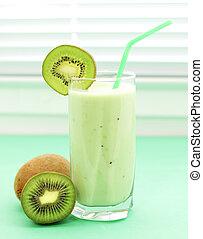 Kiwi juice in a glass on a light background