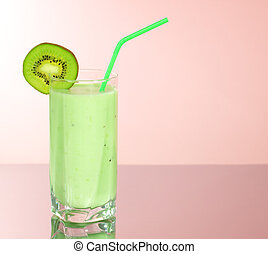 Kiwi juice in a glass on a pink background