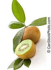 Kiwi - photo of cutted kiwi with green leaves on white...