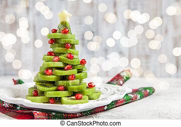 Kiwi pomegranate Christmas tree, beautiful New Year background