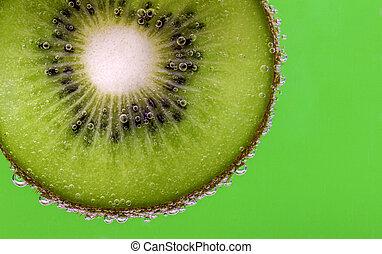 Kiwi slice carbonated water green - Closeup of a kiwi slice...