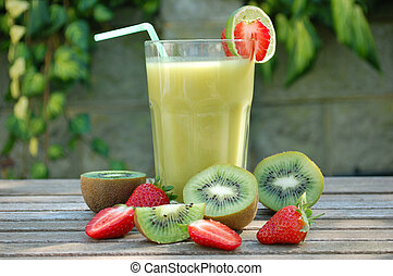 Kiwi smoothie - Refreshing tropical juice outdoors on a...