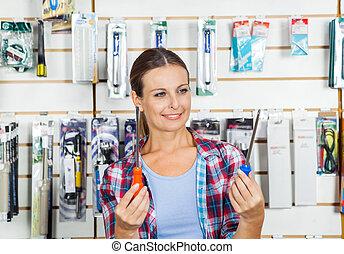 klant, het vergelijken, schroevendraaiers, winkel