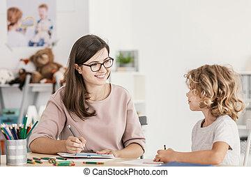 klaslokaal, jongen, autisme, het luisteren, het glimlachen, leraar