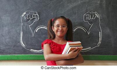 klaslokaal, spaans, boekjes , vasthouden, het glimlachen van het meisje