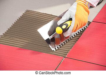 klebstoff, fliesenmuster, arbeiter, kelle, gekerbt, installieren, fliese, rotes