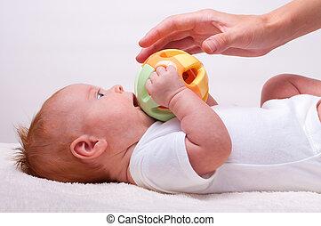 klein, baby- spielzeug, liegende