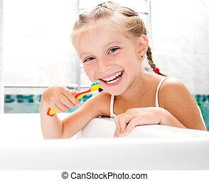klein meisje, borstelende teeth