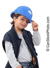 klein meisje, geklede, als, de arbeider van de bouw