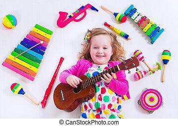 klein meisje, met, muziek instrumenten