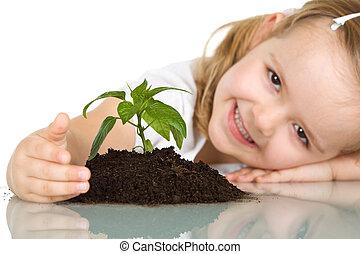 klein meisje, vrolijke , over, haar, plant