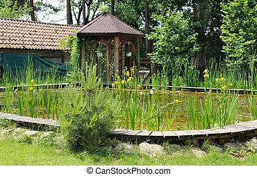 Stockfoto 39 s van houten brug kleine tuinvijver brug for Kleine tuinvijver
