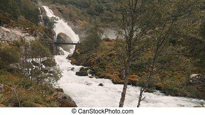 Kleivafossen Waterfall En-Route To Briksdal Glacier, Norway...