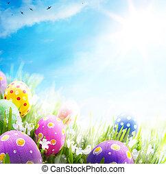 kleurrijke, paaseitjes, verfraaide, met, bloemen, in, de, gras, op, blauwe hemel, achtergrond