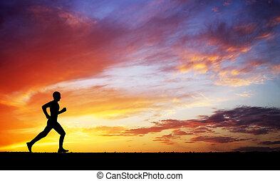 kleurrijke, sky., tegen, rennende , ondergaande zon , man