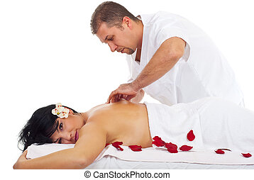 Kneaded massage on woman back at spa