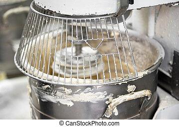 kneading dough in bakery dough mixer machine.