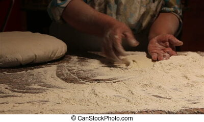 Kneading dough on board.