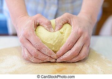 Kneading dough - Cooking: woman hands kneading dough,...