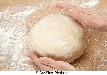 Kneading dough - Beautiful women's hands knead the dough for...