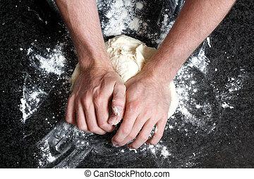 Kneading - Hands kneading a dough