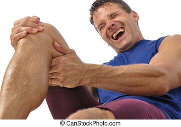 Knee and hamstring injury - Male athlete on floor clutching...