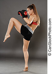 Knee hit from kickbox young woman - Kickbox girl delivering...