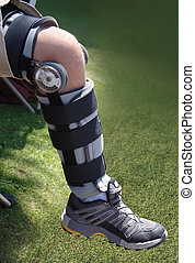 knee injury - knee brace on leg