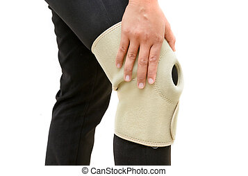 Knee injury. patient woman holds hands on knee brace