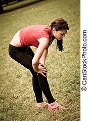 Knee injury - sportswoman in pain
