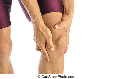 Knee injury - Male athlete in pain clutches his knee