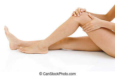 Knee Injury. - Woman holding on sore knee with white...