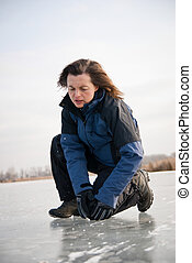 Knee injury - winter slip - Young woman with knee injury on...