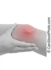 Knee injury. Woman holding her knee with highlighted pain...