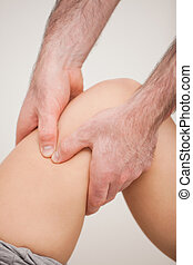 Knee of a patient being held