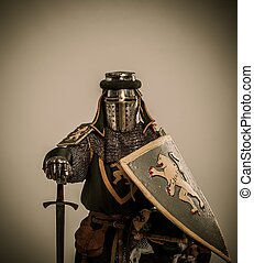 Kneeled medieval knight with sword and shield