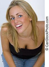 Kneeling Blonde - Studio shot of a beautiful young blonde...