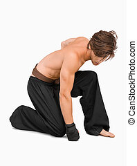 Kneeling martial arts fighter against a white background