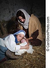 Kneeling parents in nativity scene