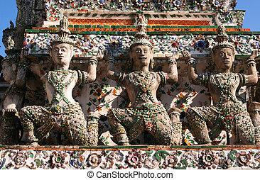 Kneeling Statues Wat Arun temple of dawn Bangkok Thailand