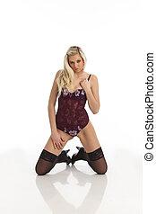 kneeling woman in underwear
