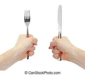 knife and fork cutlery in hands isolated - knife and fork...