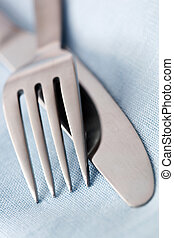 Knife and Fork in Blue Linen - Knife and fork on a pastel...